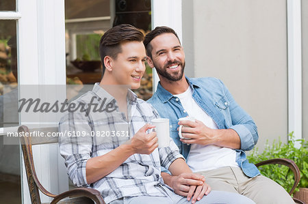 Happy homosexual couple looking away Stock Photo - Premium Royalty-Free, Image code: 6109-08203631