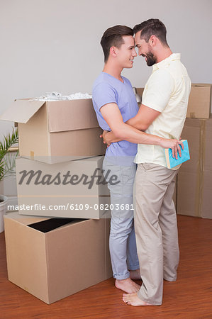 Happy homosexual couple hugging and looking at each other Stock Photo - Premium Royalty-Free, Image code: 6109-08203681