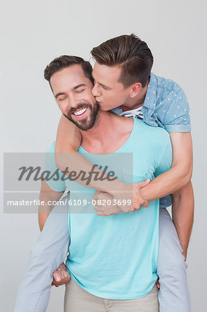 Happy homosexual couple kissing and having piggy back Stock Photo - Premium Royalty-Free, Image code: 6109-08203699