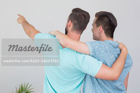 Wear view of homosexual couple looking away Stock Photo - Premium Royalty-Free, Image code: 6109-08203701