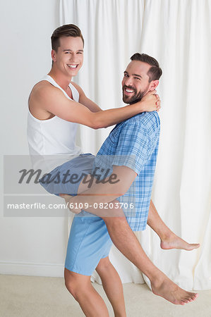 Happy homosexual couple having fun Stock Photo - Premium Royalty-Free, Image code: 6109-08203706