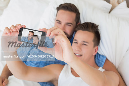 Happy homosexual taking a selfie Stock Photo - Premium Royalty-Free, Image code: 6109-08203713