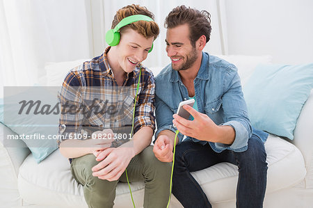 Homosexual couple men listening to music Stock Photo - Premium Royalty-Free, Image code: 6109-08203801