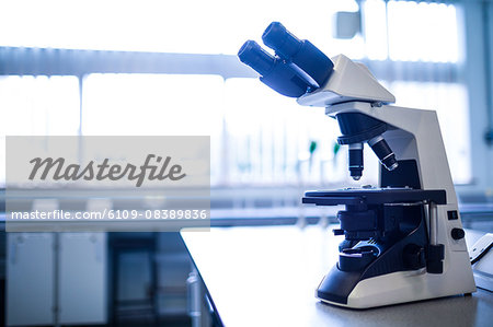 Microscope in the laboratory Stock Photo - Premium Royalty-Free, Image code: 6109-08389836