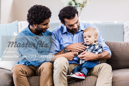 Happy gay couple with child Stock Photo - Premium Royalty-Free, Image code: 6109-08390107