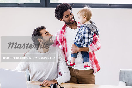 Happy gay couple with child Stock Photo - Premium Royalty-Free, Image code: 6109-08390193