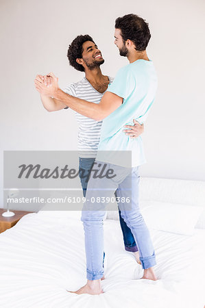 Happy gay couple dancing Stock Photo - Premium Royalty-Free, Image code: 6109-08390386