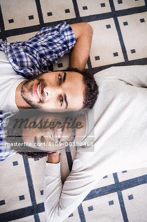 Happy gay couple laying on floor Stock Photo - Premium Royalty-Free, Image code: 6109-08390468