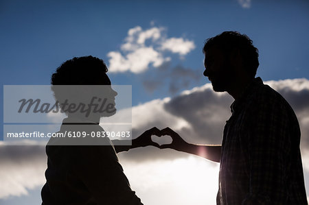Homosexual couple making hearth with hands Stock Photo - Premium Royalty-Free, Image code: 6109-08390483