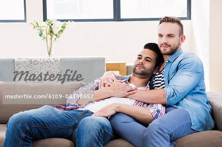 Gay couple relaxing on the couch Stock Photo - Premium Royalty-Free, Image code: 6109-08390552