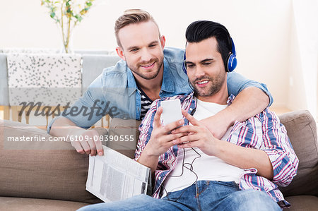 Gay couple relaxing on the couch Stock Photo - Premium Royalty-Free, Image code: 6109-08390555