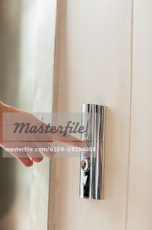 A model pushing elevator button Stock Photo - Premium Royalty-Free, Image code: 6109-08394958