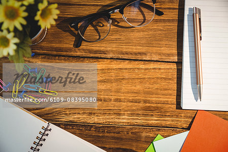 High angle view of office supplies on table Stock Photo - Premium Royalty-Free, Image code: 6109-08395080