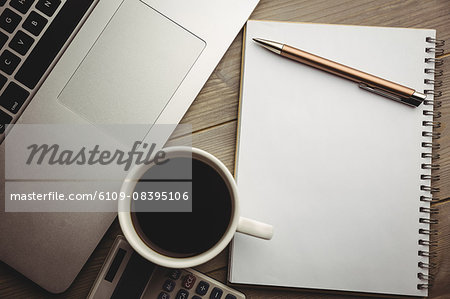 Overhead of notepad with coffee and calculator Stock Photo - Premium Royalty-Free, Image code: 6109-08395106