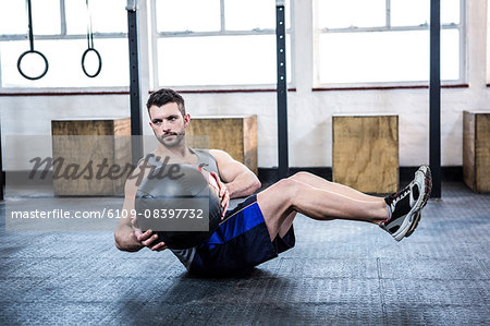 Fit man working out with ball Stock Photo - Premium Royalty-Free, Image code: 6109-08397732