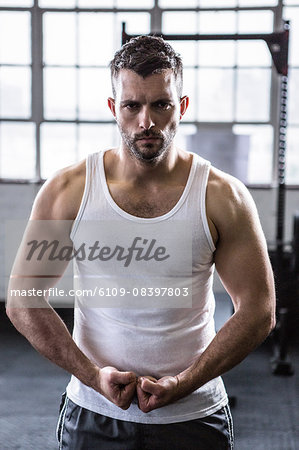 Fit man standing with fists clenched Stock Photo - Premium Royalty-Free, Image code: 6109-08397803