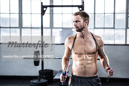 Fit man using skipping rope Stock Photo - Premium Royalty-Free, Image code: 6109-08397873