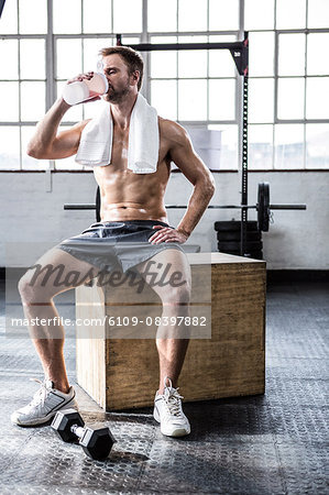 Fit man drinking his protein shake Stock Photo - Premium Royalty-Free, Image code: 6109-08397882