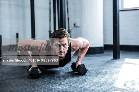 Fit man working out with dumbbells Stock Photo - Premium Royalty-Free, Image code: 6109-08397963