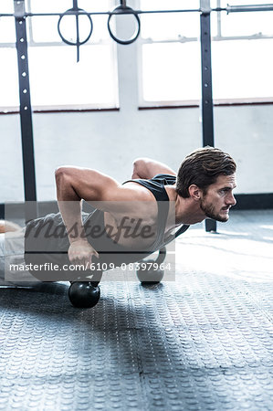 Fit man working out with kettlebells Stock Photo - Premium Royalty-Free, Image code: 6109-08397964