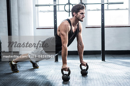 Fit man working out with kettlebells Stock Photo - Premium Royalty-Free, Image code: 6109-08397965