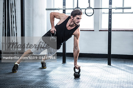 Fit man working out with kettlebells Stock Photo - Premium Royalty-Free, Image code: 6109-08397966