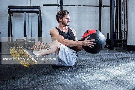 Fit man working out with ball Stock Photo - Premium Royalty-Free, Image code: 6109-08397970