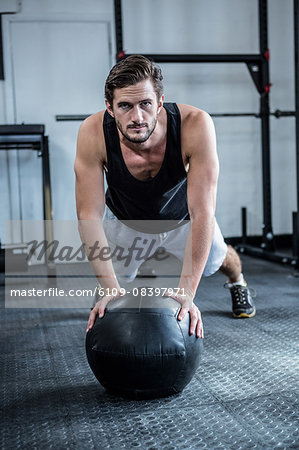 Fit man working out with ball Stock Photo - Premium Royalty-Free, Image code: 6109-08397971