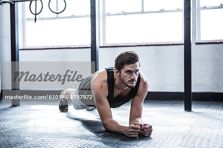 Fit man working out in studio Stock Photo - Premium Royalty-Free, Image code: 6109-08397972
