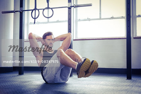 Fit man working out in studio Stock Photo - Premium Royalty-Free, Image code: 6109-08397975