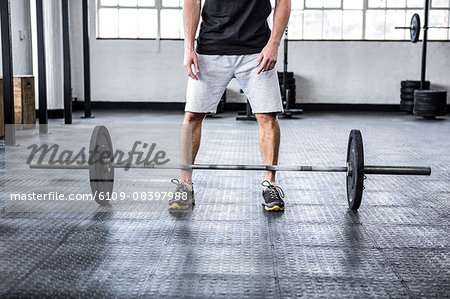 Fit man lifting heavy barbell Stock Photo - Premium Royalty-Free, Image code: 6109-08397988