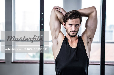 Fit man stretching his arms Stock Photo - Premium Royalty-Free, Image code: 6109-08398011