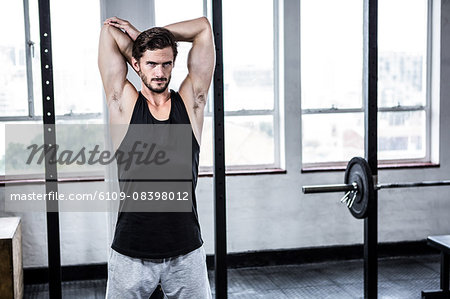 Fit man stretching his arms Stock Photo - Premium Royalty-Free, Image code: 6109-08398012