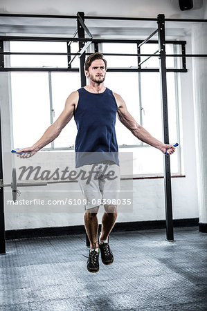 Fit man with skipping rope Stock Photo - Premium Royalty-Free, Image code: 6109-08398035