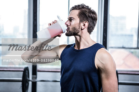 Fit man drinking his protein shake Stock Photo - Premium Royalty-Free, Image code: 6109-08398040