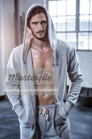 Fit shirtless man with hooded jumper Stock Photo - Premium Royalty-Free, Image code: 6109-08398072