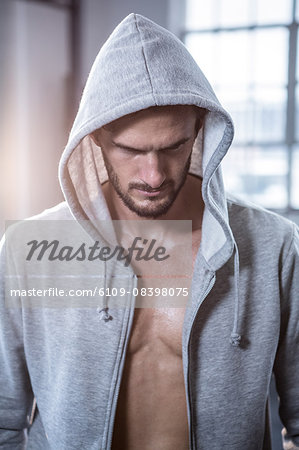 Fit shirtless man with hooded jumper Stock Photo - Premium Royalty-Free, Image code: 6109-08398075