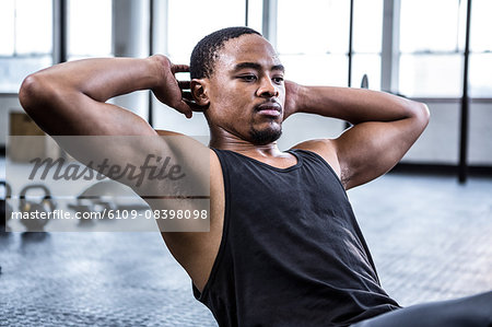 Fit man working out in studio Stock Photo - Premium Royalty-Free, Image code: 6109-08398098