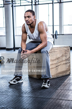 Fit man taking a break from working out Stock Photo - Premium Royalty-Free, Image code: 6109-08398107