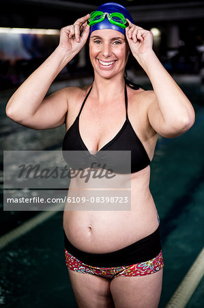 Pregnant woman smiling Stock Photo - Premium Royalty-Free, Image code: 6109-08398723