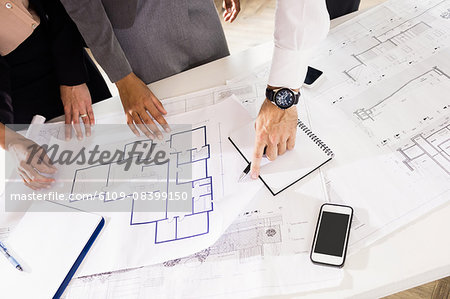 Business people discussing layouts Stock Photo - Premium Royalty-Free, Image code: 6109-08399150