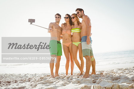 Happy friends taking a selfie Stock Photo - Premium Royalty-Free, Image code: 6109-08536795