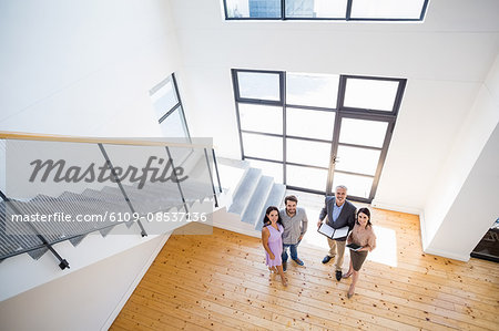 Real estate agent showing new house to couple Stock Photo - Premium Royalty-Free, Image code: 6109-08537136