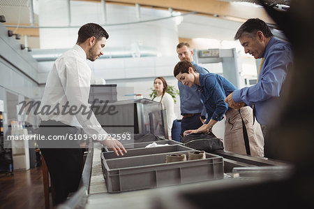 Passengers in airport security check at airport Stock Photo - Premium Royalty-Free, Image code: 6109-08722593