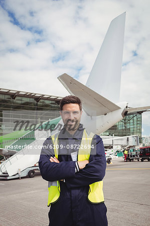 Portrait of airport ground crew standing on runway at airport terminal Stock Photo - Premium Royalty-Free, Image code: 6109-08722694