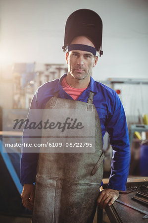 Portrait of male welder standing in workshop Stock Photo - Premium Royalty-Free, Image code: 6109-08722795