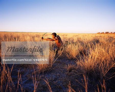 Bushmen Hunting in Grassy Field Namibia, Africa Stock Photo - Premium Royalty-Free, Image code: 6110-08697975