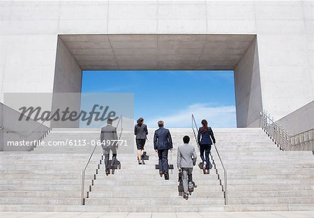 Business people ascending modern stairs Stock Photo - Premium Royalty-Free, Image code: 6113-06497771