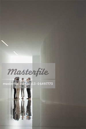 Business people meeting in corridor Stock Photo - Premium Royalty-Free, Image code: 6113-06497773