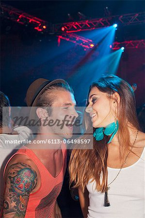 Smiling couple dancing at nightclub Stock Photo - Premium Royalty-Free, Image code: 6113-06498597